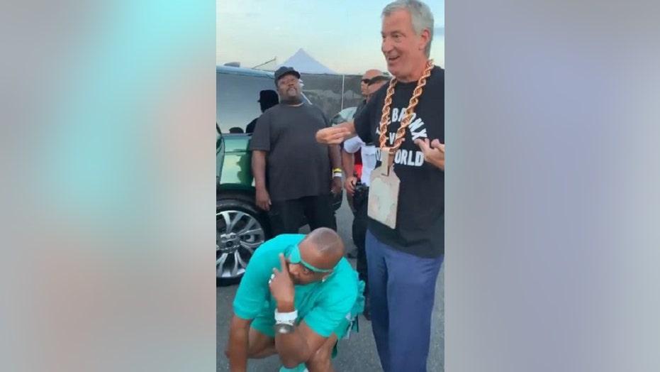 NYC Mayor de Blasio sports rapper Slick Rick's chain on first night of hip hop shows across city