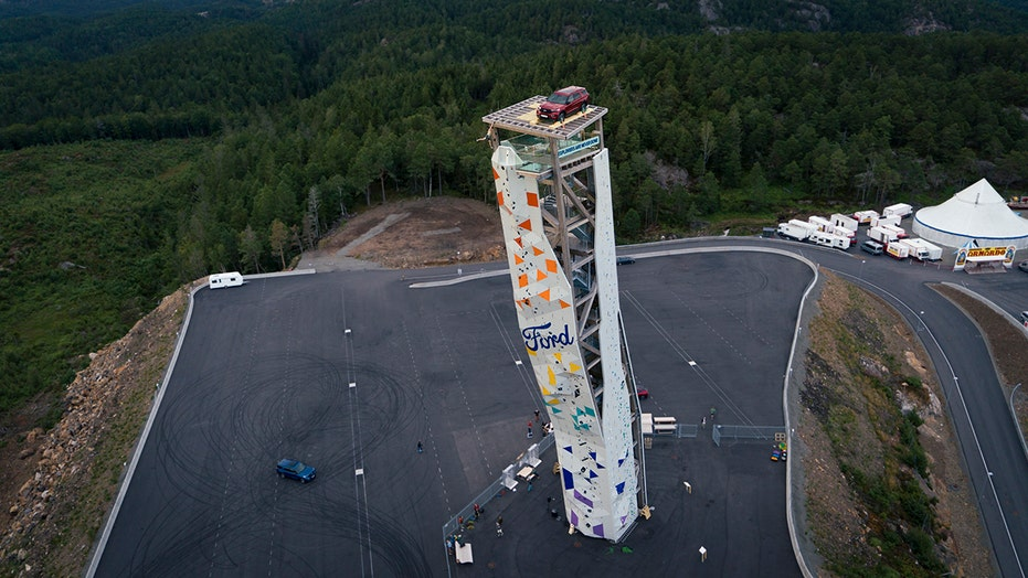 Climber scales tower to win free Ford Explorer parked on top