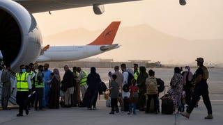Biden administration resumes Afghan refugee flights after measles outbreak