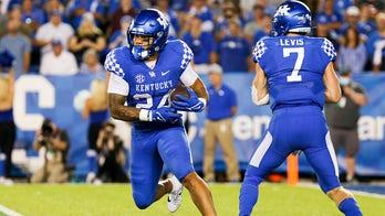 Rodriguez's 3 TDs help Kentucky hold off Missouri 35-28