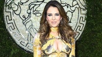 Elizabeth Hurley, 56, glows in low-cut couture alongside Demi Moore, son Damian at Milan Fashion Week