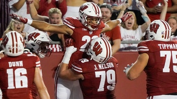 Mellusi powers No. 18 Wisconsin past Eastern Michigan 37-7