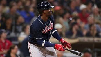 Soler, Braves win 10-8 in 10 innings to eliminate Padres