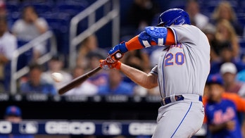 Alonso homers twice, including 100th, as Mets top Marlins