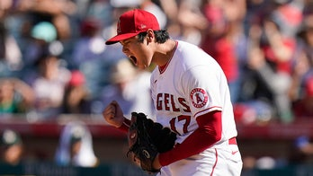 Ohtani strkes out 10, A's beat Angels 3-2, stay in WC race