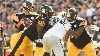 Steelers' Mike Tomlin defends Trai Turner after ejection: 'Somebody spit in his face'