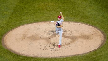 Wheeler, Phillies hold off Mets 4-3 to boost playoff hopes