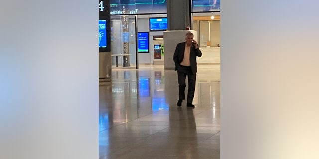 McAuliffe seen in New York Penn Station's Moynihan Train Hall without a face mask. Federal mask mandates require face coverings on public transportation and in all public transportation hubs including airports and train stations.
