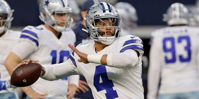 Dallas Cowboys quarterback Dak Prescott (4) warms up before an NFL football game against the Philadelphia Eagles in Arlington, Texas, Monday, Sept. 27, 2021.