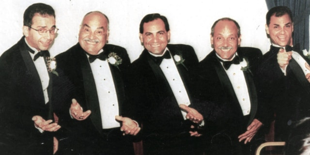 Adam Arias (right) pictured with his brothers and father (Don Arias)
