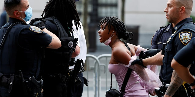 Police detain demonstrators attending a Black Lives Matter (BLM) protest at the Met Gala 2021 at the Metropolitan Museum of Art in New York City, New York, U.S. September 13, 2021.