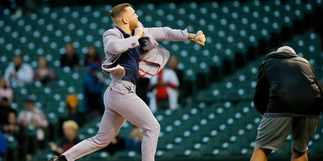 Sep 21, 2021; Chicago, Illinois, USA; MMA fighter Conor McGregor throws out a ceremonial first pitch before the game between the Chicago Cubs and the Minnesota Twins at Wrigley Field. Mandatory Credit: Jon Durr-USA TODAY Sports