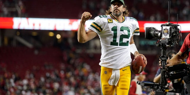 Sep 26, 2021; Santa Clara, California, USA; Green Bay Packers quarterback Aaron Rodgers (12) jogs towards the locker room after the Packers defeated the San Francisco 49ers 30-28 at Levi's Stadium. Mandatory Credit: Cary Edmondson-USA TODAY Sports