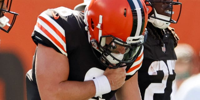 Cleveland Browns quarterback Baker Mayfield holds his shoulder after getting hurt during the first half of an NFL football game against the Houston Texans, Sunday, Sept. 19, 2021, in Cleveland.