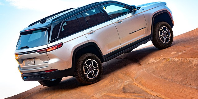 The Grand Cherokee Trailhawk 4xe's air suspension provides up to 10.9 inches of ground clearance.