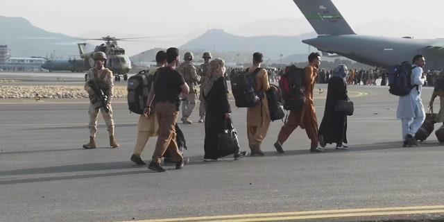 Refugees flee Afghanistan on August 22, 2021. (Fox News)