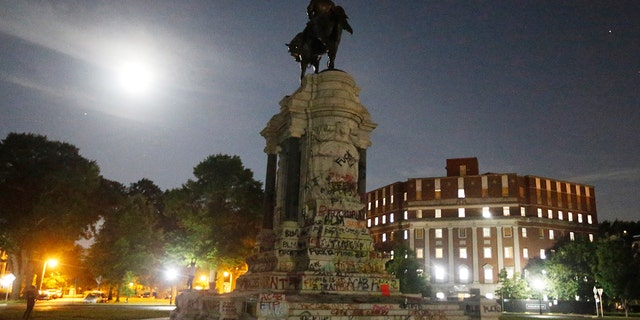 The moon illuminates the statue of Confederate General Robert E. Lee on Monument Avenue Friday June. 5, 2020, in Richmond, Virginia. (Associated Press)