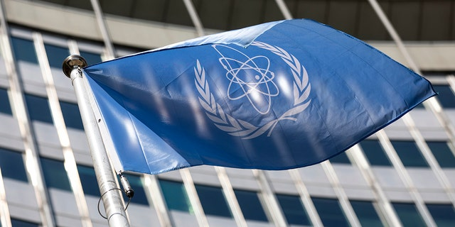 In this Monday, June 7, 2021 file photo, the flag of the International Atomic Energy Agency (IAEA) waves at the entrance of the Vienna International Center in Vienna.