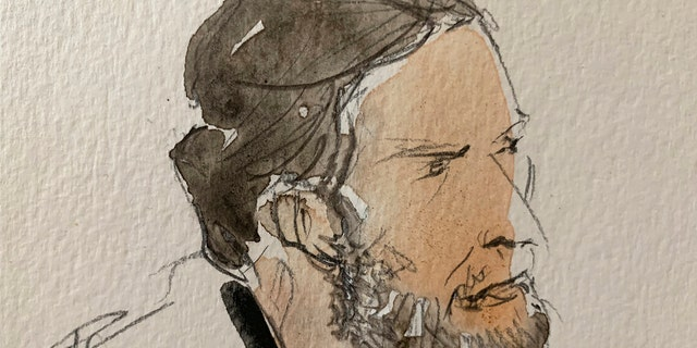 This courtroom sketch shows key defendant Salah Abdeslam, in the special courtroom built for the 2015 attacks trial, Wednesday, Sept. 8, 2021 in Paris.