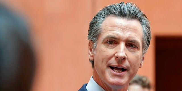 California Gov. Gavin Newsom responds to a question while meeting with reporters after casting his recall ballot at a voting center in Sacramento, Calif on Sept. 10, 2021. (AP Photo/Rich Pedroncelli, File)