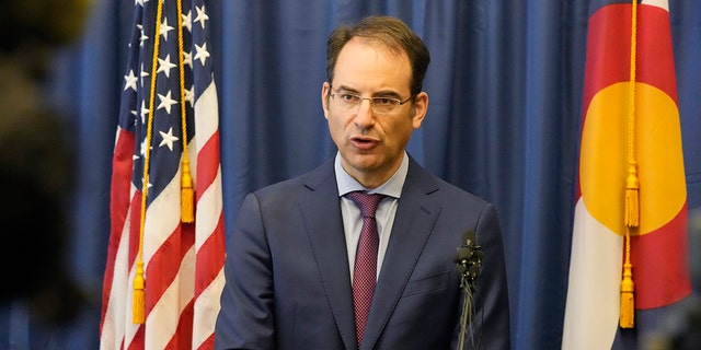 In this Sept. 1, 2021, file photo, Colorado Attorney General Phil Weiser talks about a grand jury investigation into the death of Elijah McClain, a Black man who was put in a chokehold by police and injected with a powerful sedative two years ago, during a news conference in Denver.