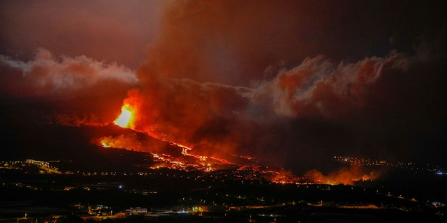 Lava erupts from a volcano near El Paso on the island of La Palma in the Canaries, Spain, Monday Sept. 20.