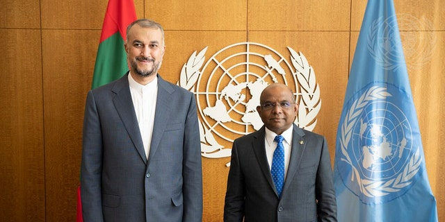 In this photo provided by the United Nations, United Nations General Assembly President Abdulla Shahid of Maldives, right, meets with Iran's Foreign Minister Hossein Amir Abdollahian during the 76th session of the United Nations General Assembly, Thursday, Sept. 23, 2021, at UN headquarters.
