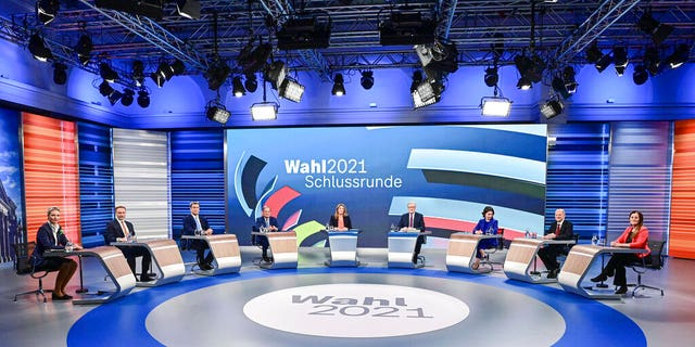 Candidates for the German election attended a final televised debate in Berlin, Thursday Sept. 23, 2021. From left to 4th left, Alice Weidel, Alice Weidel, co-leader of the Alternative for Germany party (AfD), Christian Lindner, leader of the Free Democratic Party (FDP), Markus Soeder, Christian Social Union party leader and Bavarian Prime Minister, Armin Laschet, chairman of the German Christian Democratic Union. From 3rd right to right, Annalena Baerbock, Green Party co-leader, Olaf Scholz, Finance Minister and SPD candidate, and Janine Wissler, co-leader of the left party Die Linke. (Tobias Schwarz/Pool via AP)