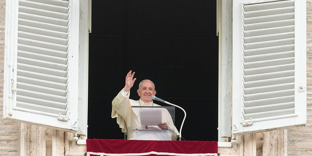 Pope Francis waves to faithful during the Angelus noon prayer in St. Peter's Square at the Vatican, Sunday, Sept 26, 2021. (AP Photo/Andrew Medichini)