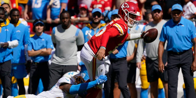 Kansas City Chiefs quarterback Patrick Mahomes (15) is tackled by Los Angeles Chargers' Kyzir White (44) during the first half of an NFL football game, Sunday, Sept. 26, 2021, in Kansas City, Mo.