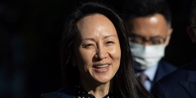 In this Sept. 24, 2021, file photo, Meng Wanzhou, chief financial officer of Huawei, smiles as she leaves her home in Vancouver. A pair of American siblings, Cynthia and Victor Liu, have returned to the U.S. on Sunday, Sept. 26, 2021, after China lifted an exit ban following Canada's release of Meng wanted in the U.S. on fraud charges.
