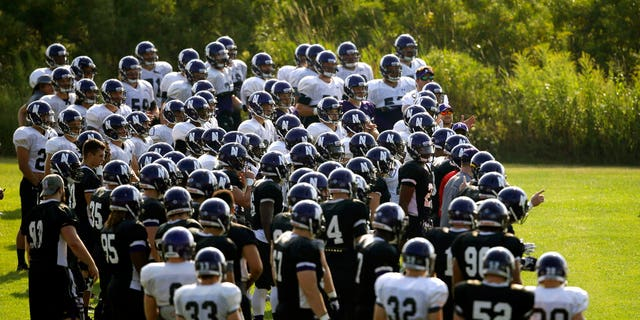FILE: Northwestern football players gather during practice at the University of Wisconsin-Parkside campus in Kenosha, Wisc., in this Monday, Aug. 17, 2015, file photo.