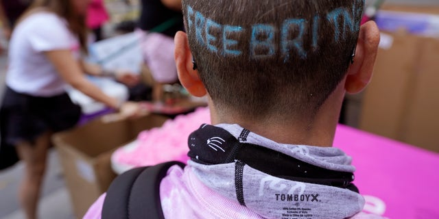 """Britney Spears supporter Kim Van Doorn of Bakersfield, Calif., shows off a """"Free Britney"""" design in her hair outside the Stanley Mosk Courthouse, Wednesday, Sept. 29, 2021, in Los Angeles. (AP Photo/Chris Pizzello)"""