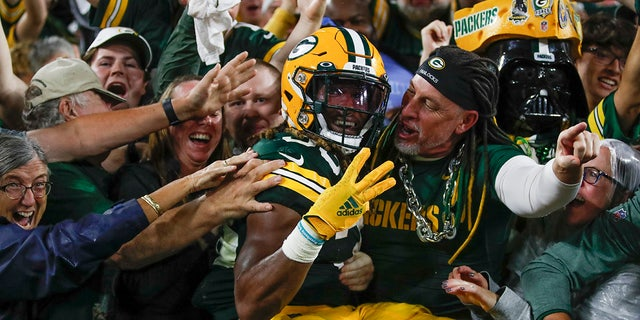 Green Bay Packers' Aaron Jones celebrates his touchdown run during the second half of an NFL football game against the Detroit Lions Monday, Sett. 20, 2021, a Green Bay, Wis.