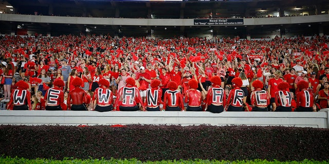 Georgia Bulldogs fans show their support for recruiting Arch Manning who attended during the game between the South Carolina Gamecocks and the Georgia Bulldogs at Sanford Stadium on September 18, 2021 in Athens, Georgia.