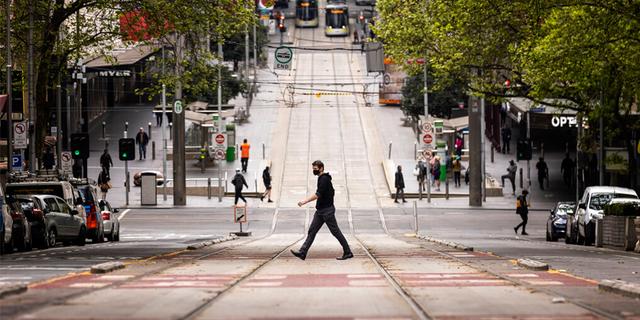 People cross Bourke Street in Melbourne, Thursday, Sept. 30, 2021.