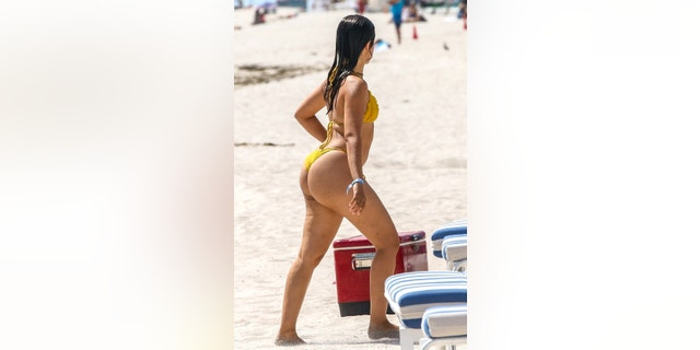Cabello was snapped while going for a dip and displaying her bikini body in a yellow two-piece.