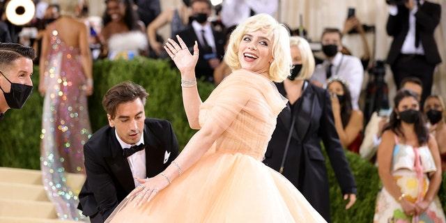 2021 Met Gala co-chair Billie Eilish attends the 2021 Met Gala Celebrating In America: A Lexicon Of Fashion at Metropolitan Museum of Art. The singer is wearing custom Oscar de la Renta.