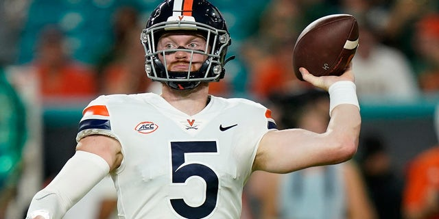 Virginia Cavaliers quarterback Brennan Armstrong (5) aims a pass during the first half of a NCAA college football game against the Miami Hurricanes, Thursday, Sept. 30, 2021, in Miami Gardens, Fla.
