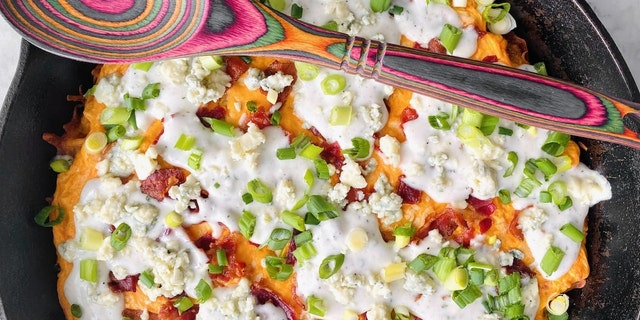 """The recipe combines the tangy taste of buffalo chicken dip with crispy tater tots, two """"favorite football party foods,"""" according to Morgan's blog post."""
