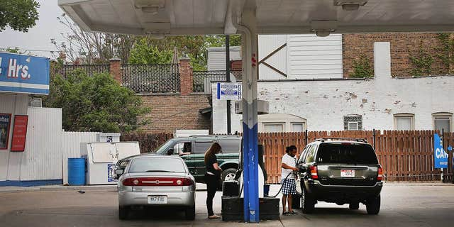 Customers purchase gasoline at a Marathon gas station in Chicago, Illinois.
