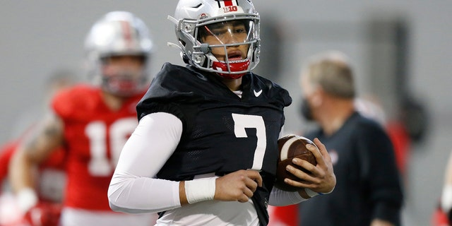 In this April 5, 2021 file photo, Ohio State quarterback CJ Stroud performs a workout during NCAA college football practice in Columbus, Ohio.