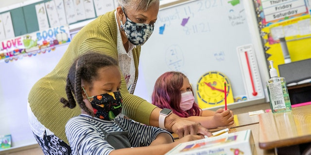 In this Aug. 11, 2021, file photo, Joy Harrison instructs her second-graders at Carl B. Munck Elementary School, in Oakland, Calif. (Santiago Mejia/San Francisco Chronicle via AP, Pool, File)