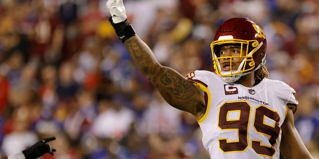 Washington Football Team defensive end Chase Young (99) gestures to fans against the New York Giants in the fourth quarter at FedExField.