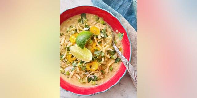 White corn chicken chili combines shredded chicken, cilantro and spices to create a classic southwestern flavored dish.