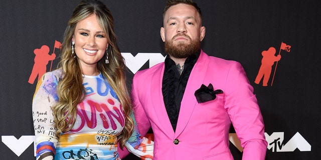 Dee Devlin, left, and Conor McGregor arrive at the MTV Video Music Awards at Barclays Center on Sunday, Sept. 12, 2021, in New York. (Photo by Evan Agostini/Invision/AP)