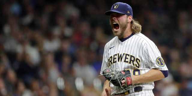 Milwaukee Brewers' Corbin Burnes reacts after striking out a batter during the seventh inning of a baseball game against the New York Mets Saturday, Sept. 25, 2021, in Milwaukee.