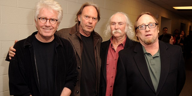 Musicians Graham Nash, Stephen Stills, David Crosby and Neil Young.