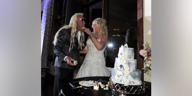 Dog wore a black tuxedo but kept his trademark shades on and had tribal braids in his hair while Francie wore a traditional white dress and crystal-encrusted sneakers.