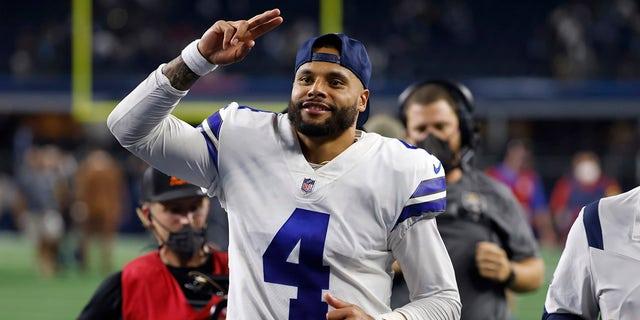 Dallas Cowboys quarterback Dak Prescott (4) acknowledges fans as he jogs off the field after their NFL football game against the Philadelphia Eagles in Arlington, Texas, Monday, Sept. 27, 2021.